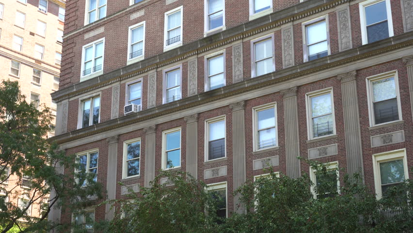 Close up establishing shot of a brick apartment building during the day. New York Chicago Boston LA Los Angeles type setting.