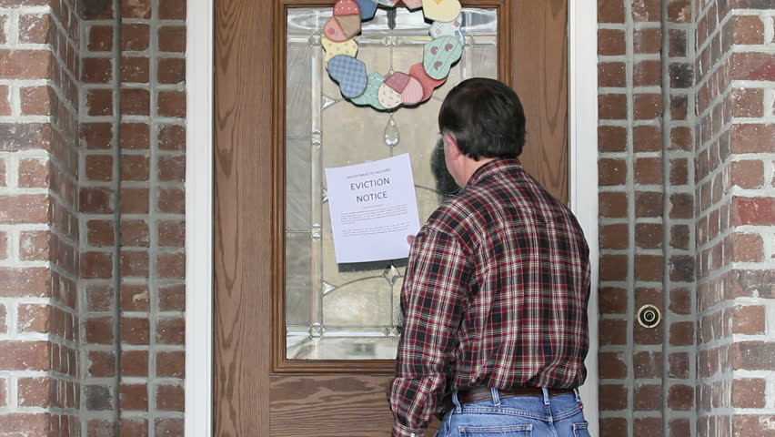 Eviction Notice On Front Door Of House As Home Owner