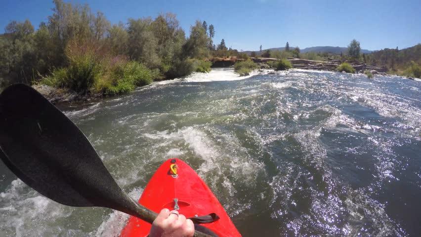POV of kayaker running class IV powerhouse rapid...