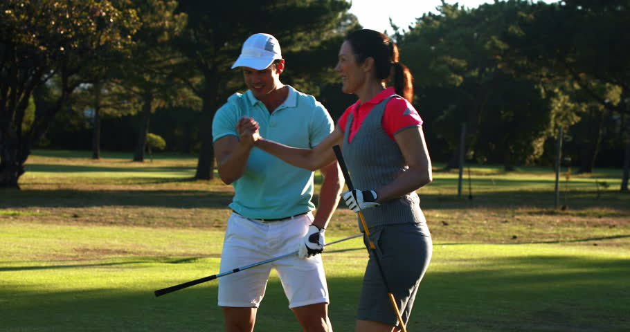 Excited golf players giving high five at golf course 4k