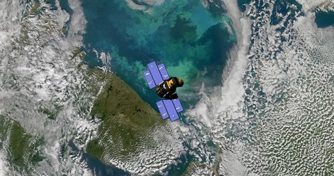 Top view of Earth-observing ICESat spacecraft in orbit above The Barents Sea. Elements of this image furnished by NASA
