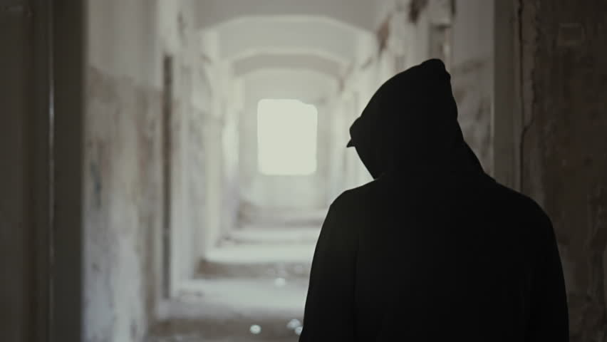 Hooded young man wondering inside destroyed abandoned building,slow motion,dramatic.Young man with social issues, walks inside a big wrecked empty building in 100fps slow motion.Camera gimbal motion. | Shutterstock HD Video #19538128