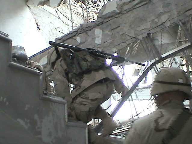 BAGHDAD, IRAQ - CIRCA 5/11/03: U.S. Soldiers survey blast damage from Tomahawk and JDAM munitions; Baath Party HQ and other buildings at Abu Ghraib Complex.