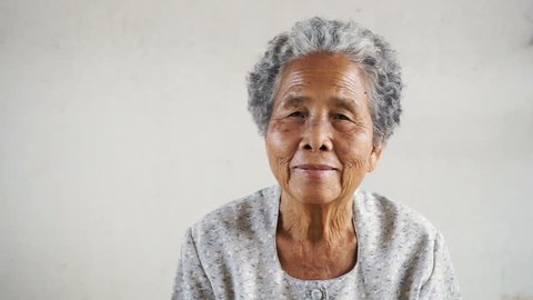 Happy Asian Grandmother on white background, The culture of Asian old women concept