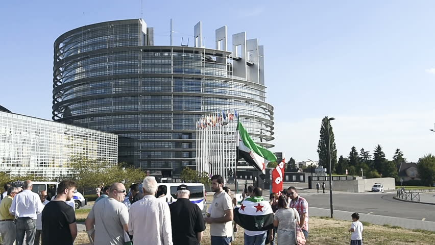 STRASBOURG, FRANCE - AUG 20, 2015: Syrian diaspora protests in front of European Parliament denouncing the Syrian airstrikes on Douma where more 80 were killed