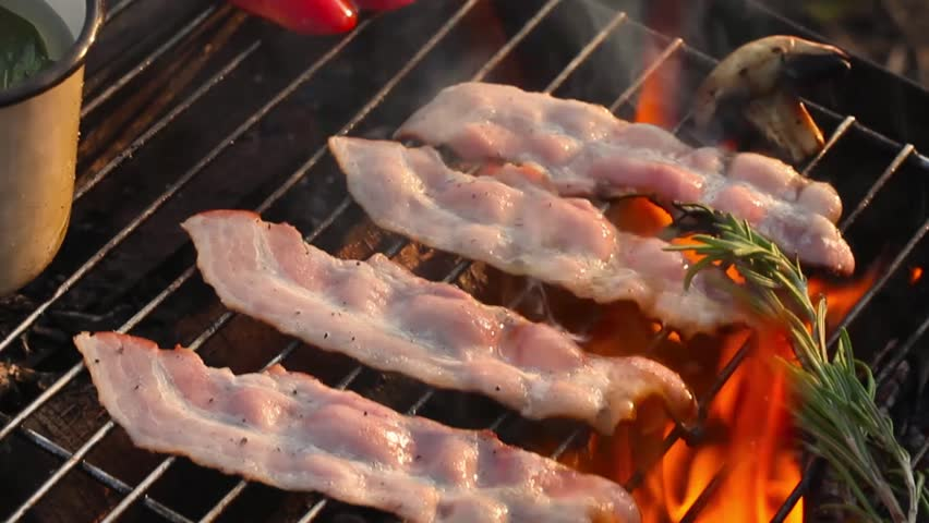 Bacon fried on a grill fire flame grill rosemary closeup | Shutterstock HD Video #19611334