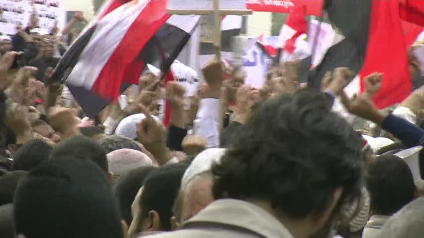 CAIRO, EGYPT - NOV 20: Young protesters in Tahrir Square chant slogans on November 20, 2011 in Cairo, Egypt.