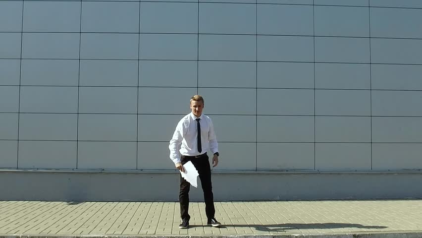 Businessman throws up the paper and do back flip. Slow motion | Shutterstock HD Video #19668304