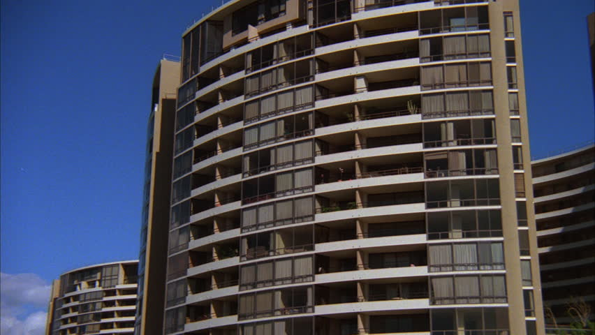 Washington dc feb 2012 imf international monetary fund day tilt up top tall large modern rounded apartment condo complex hd stock footage clip sciox Images