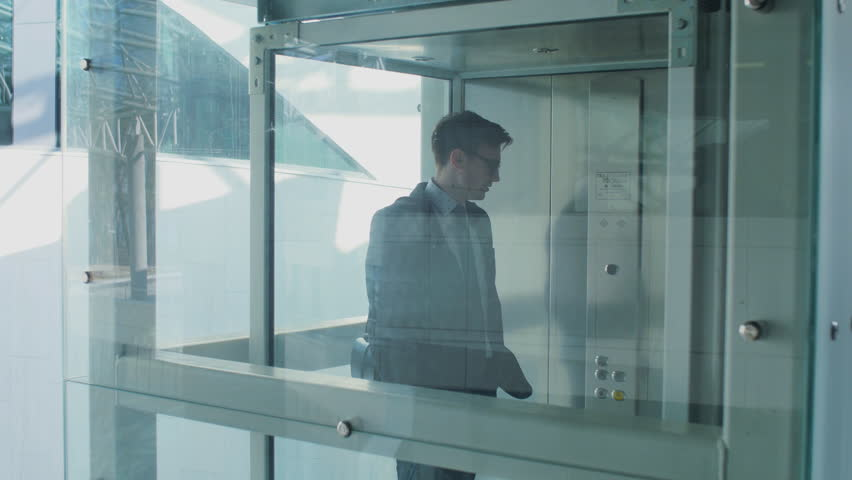 Lift in a Business Center. The men met each other in the elevator and started a conversation. | Shutterstock HD Video #19699564