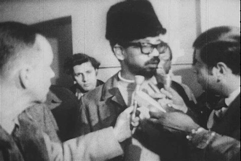 Black Panther Minister of Defense Bobby Rush speaks to reporters and an attorney for the Black Panthers reads from a Grand Jury report in 1970. (1970s)