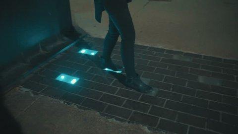 Girl lights up sidewalk with her feet