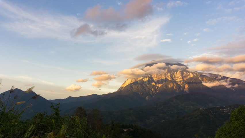 Time lapse of sunset and lenticular clouds over Mount Kinabalu in Sabah Borneo, Malaysia.