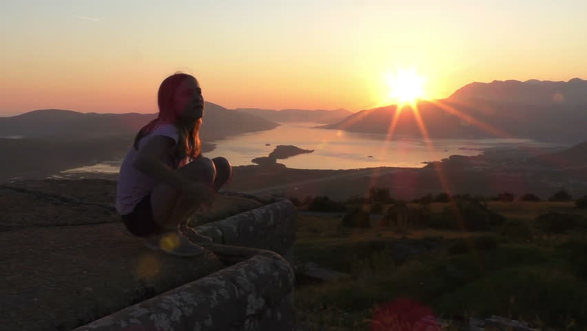 Happy good fit girl at beautiful sunset. Super slow motion Long shot, Establishing shot in Montenegro, Adriatic sea coast. Contains child/girl 10-12 years.    Shutterstock HD Video #19751164