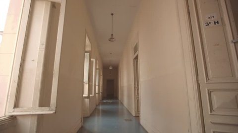 Dirty empty corridor, name of classroom at abandoned school building. Traveling in/out