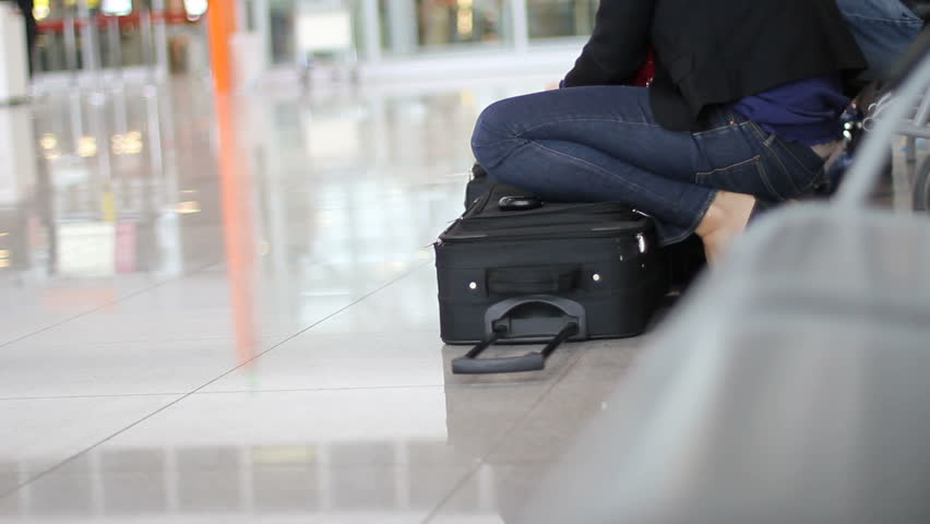 Woman packs passport in her luggage case at the airport