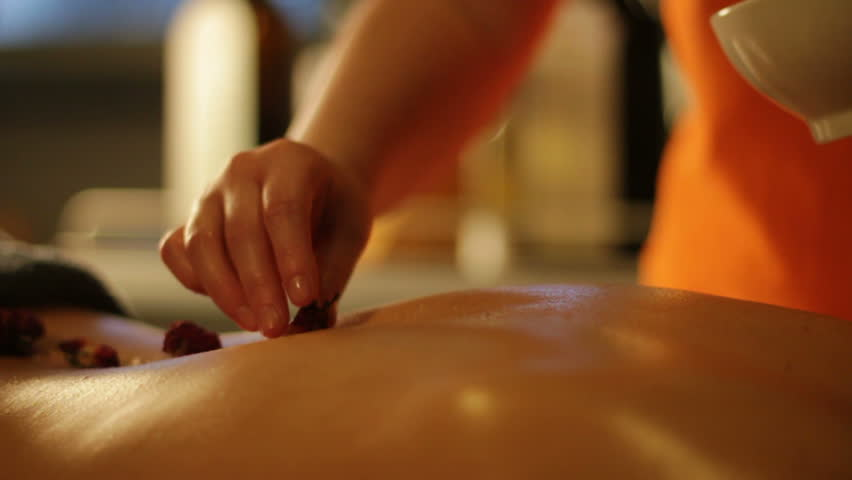 Herbal treatment at spa in slow motion