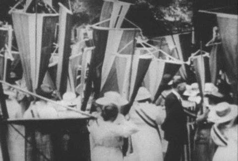 Archival footage shows American suffragettes marching and campaigning for their rights (narrated in 1961). (1960s)