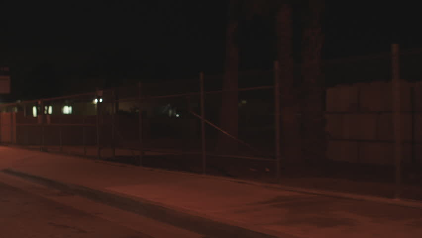 Night process plates 45 forward passenger intentional soft focus driving main city street passing mostly one story businesses rural suburb, more industrial street, eventually stops | Shutterstock HD Video #19823824