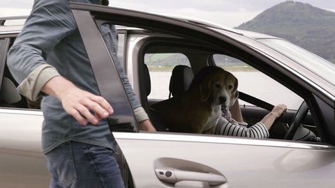 Family gets in a car with their dog and continue to ride
