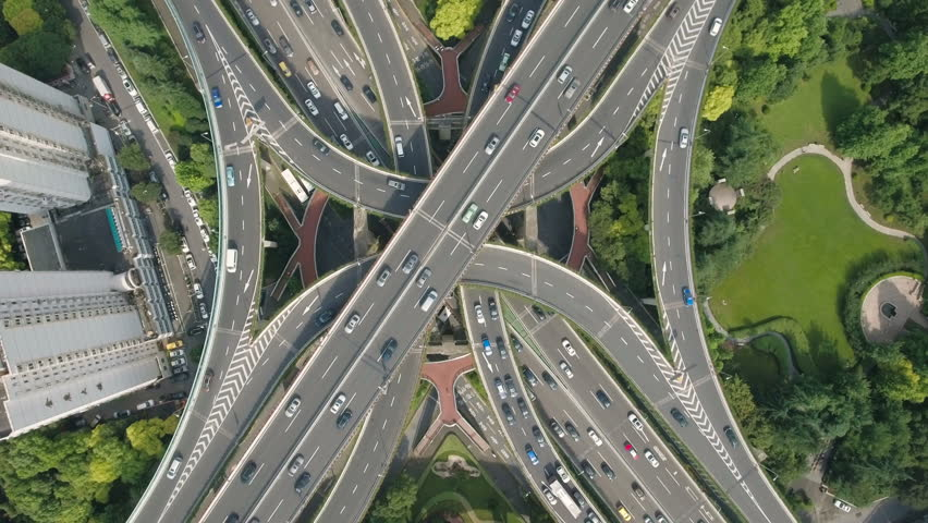 Overhead aerial drone view of the enormous Yan'an elevated freeway intersection, one of the busiest converging road junctions in Shanghai, urban China.