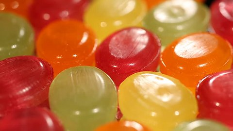 Assortment of colorful hard candies at confectionery shop, variety of sweets