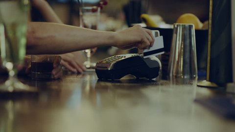 bartender gives a Terminal for payment
