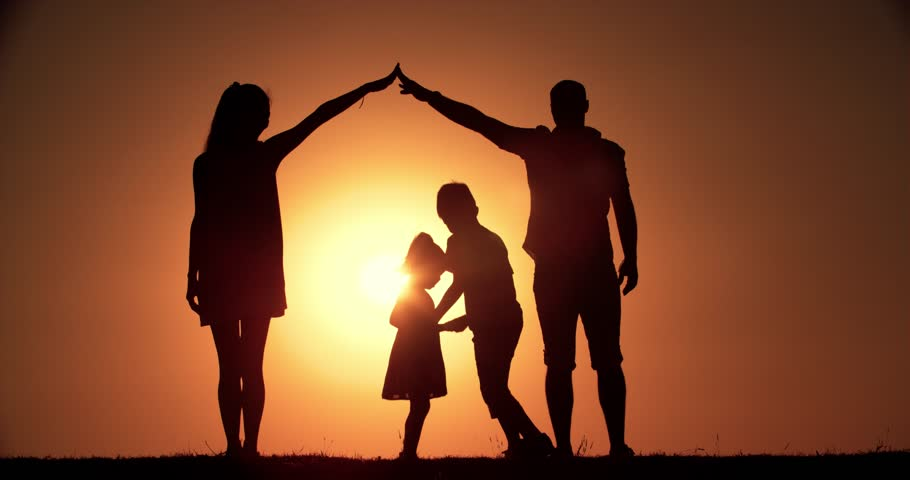 4K, home concept, family silhouette father, mother, two children, dream of buying a house, playing in the background of the sunset, slow motion   Shutterstock HD Video #19892344