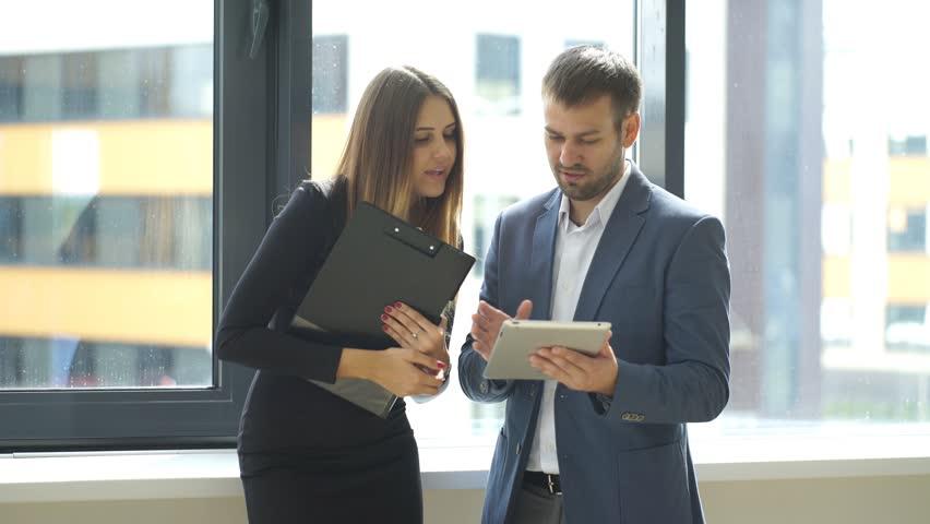 Successful businessmen discussing business plan near the window | Shutterstock HD Video #19909834