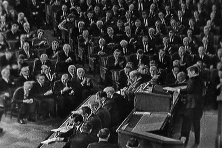 President Kennedy leaves the room after his 1963 State of the Union address to tumultuous applause. (1960s)