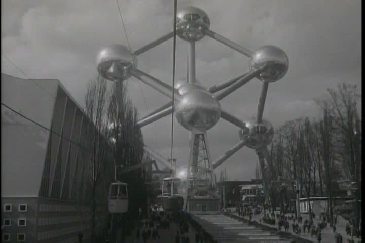 The Brussels World\xCDs Fair features a cable car sky ride, the American Pavilion and the Atomium building in 1958. (1950s)