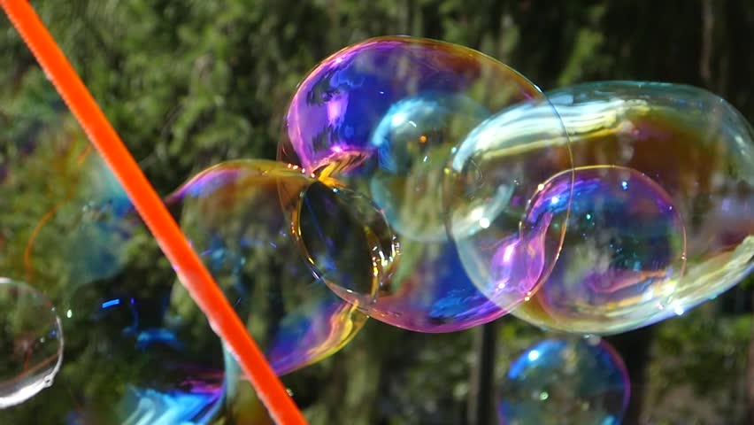 Woman blow a beautiful colored soap bubbles outdoors in public park slow motion | Shutterstock HD Video #19964584