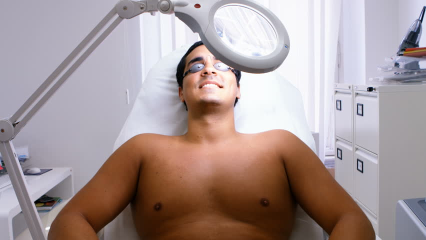 Male Patient Lying On Surgical Chair After Getting Waxed In Clinic 4k