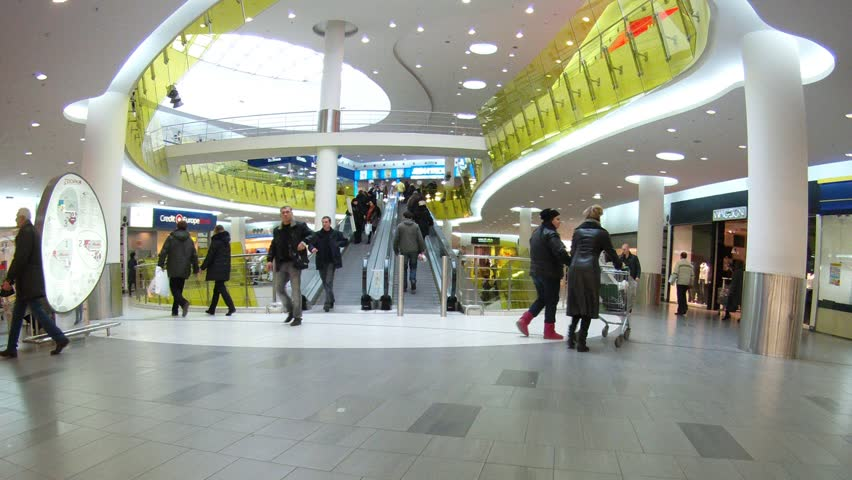 MOSCOW - DEC 21: (Timelapse View) People rise and go down on escalator  in shopping center Troika, on Dec 21, 2011 in Moscow, Russia. Russian spending in the week leading up to the big New Year's holiday was 16 per cent higher this year than in 2010.