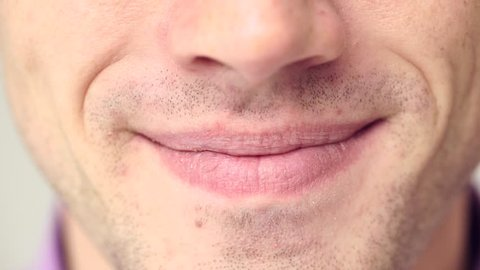 Extreme close up of a man's mouth and teeth when he smiles 4K