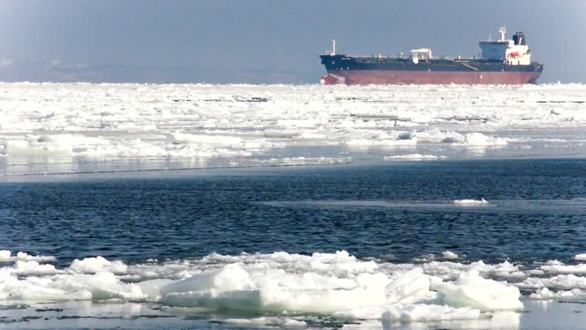 the ship sails through the sea ice in the winter, close-up