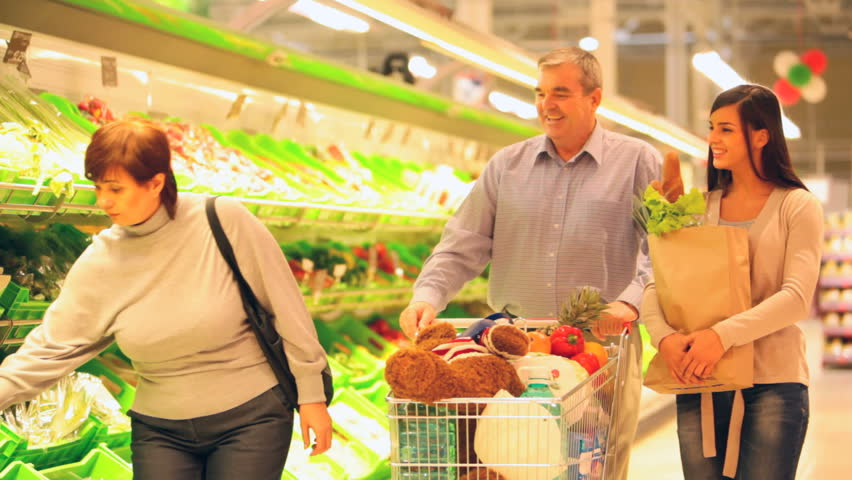 Happy family of four walking through the supermarket with a cart full of groceries, little boy coming with a pineapple | Shutterstock HD Video #2005154