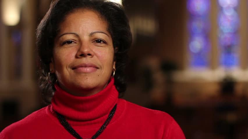 Woman at church, looking at camera | Shutterstock HD Video #2005844