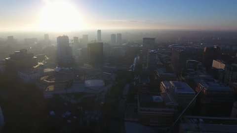 Aerial view of the Birmingham skyline and canal at sunrise.