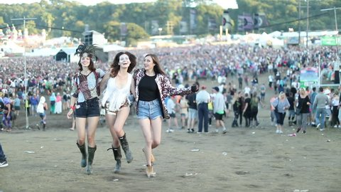 Young adult female friends having fun at festival