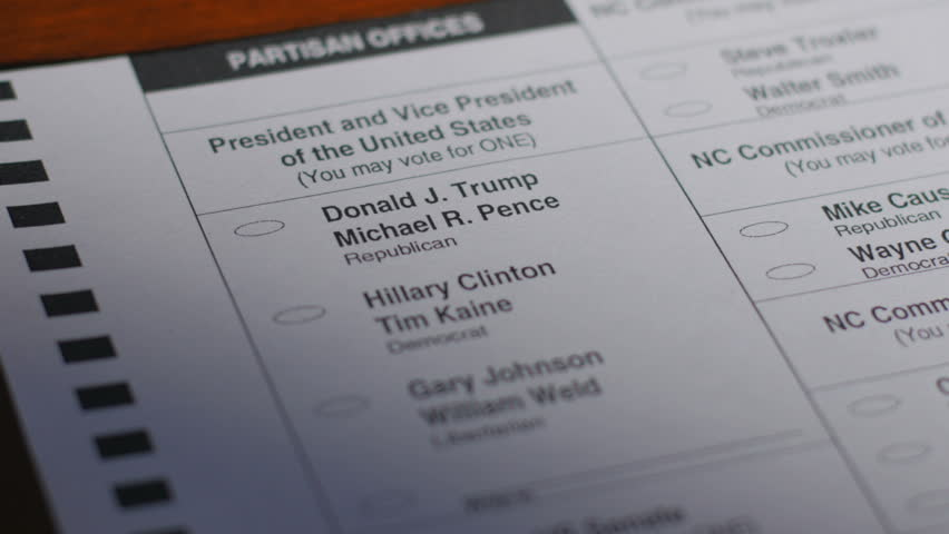 ASHEVILLE, NC - CIRCA OCTOBER 2016 - A voter's ballot is crumbled up while voting for Donald Trump during the 2016 general presidential election