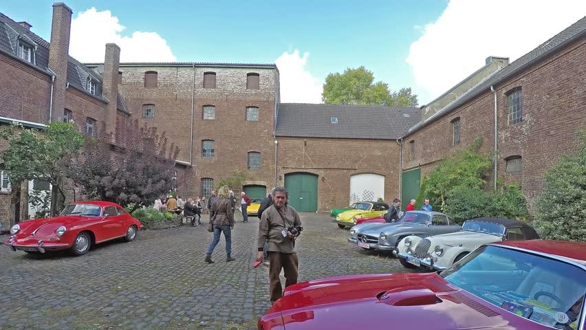 MOERS / GERMANY - OCTOBER 03 2016 : Visitors enjoying the Oldtimer fair at castle Lauersfort