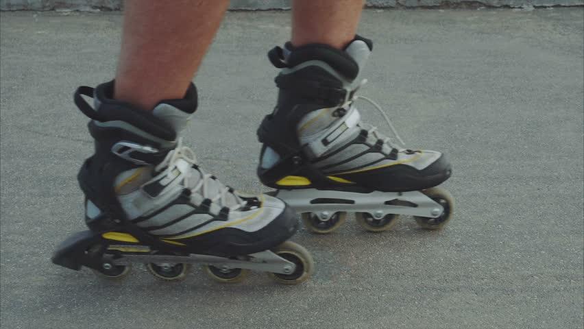 Mans legs roller skating inline close up on the asphalt 4K | Shutterstock HD Video #20140504