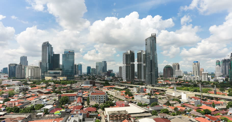 Time lapse, with a zoom out effect, of clouds moving above the business district between Kuningan and Sudirman in downtown Jakarta, Indonesia capital city on the Java island.