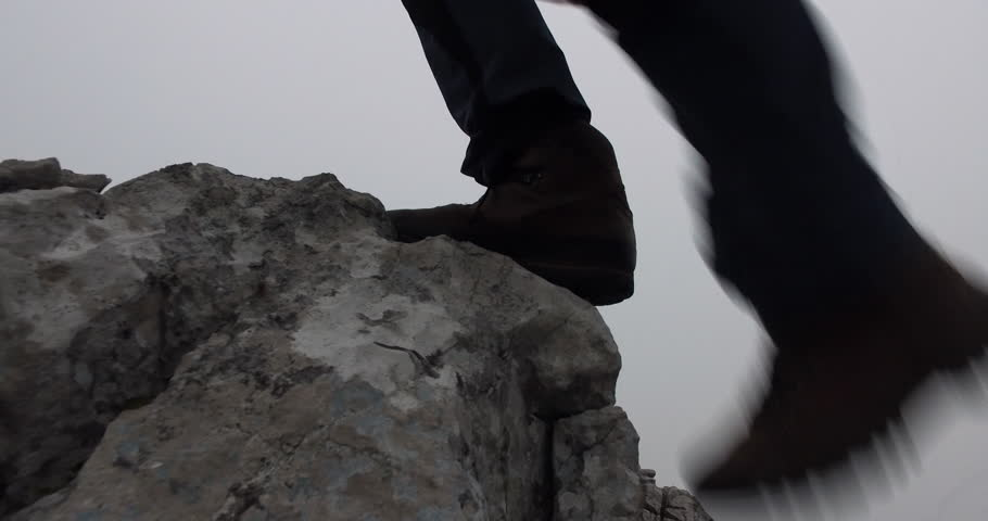 Mountaineering boots steps on rock | Shutterstock HD Video #20174854