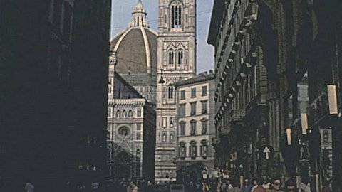 FLORENCE - 1979: people walk in front of the Duomo in 1979 in Florence