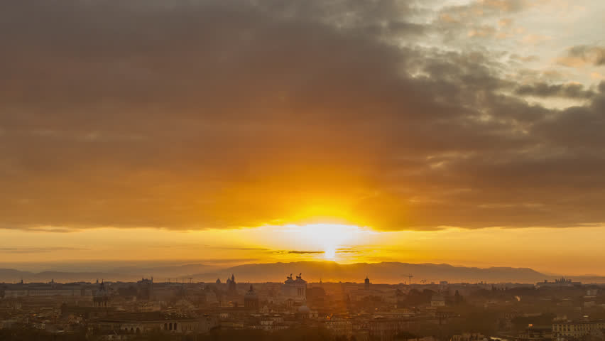 Aerial Timelapse of sunrise above the Rome city, Italy. April, 2016. Time lapse.