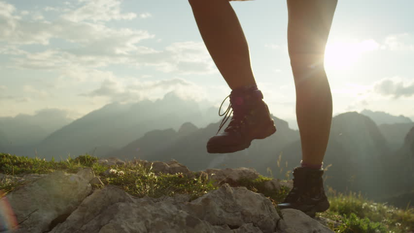 SLOW MOTION, CLOSE UP: Courageous female hiker climbing mountaintop, walking off trail on dangerous rough rocky mountain ridge. Steep wall opening beautiful view on high European Alps sunbathing | Shutterstock HD Video #20183839