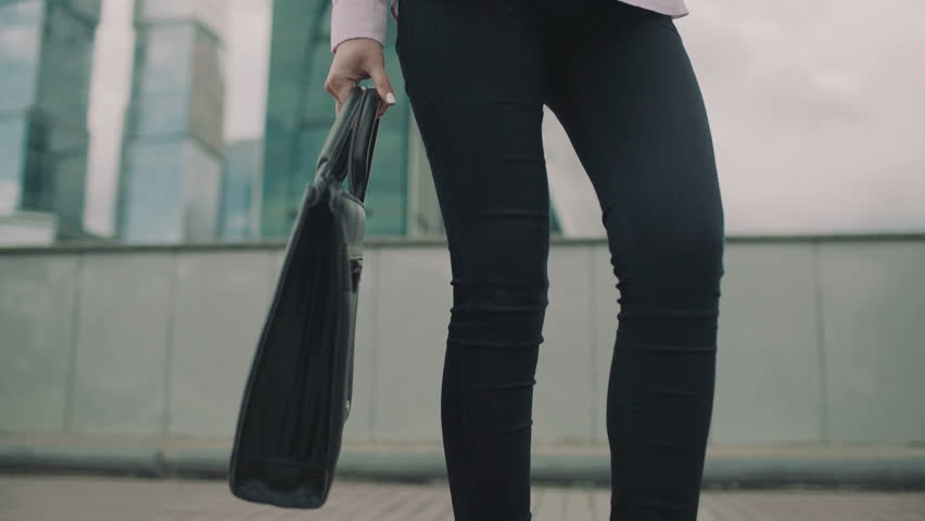 Business girl with a bag goes in the city | Shutterstock HD Video #20201254