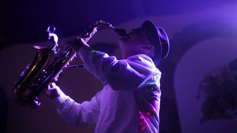 Musician playing alto saxophone on a gig, playing the saxophone, jazz, music